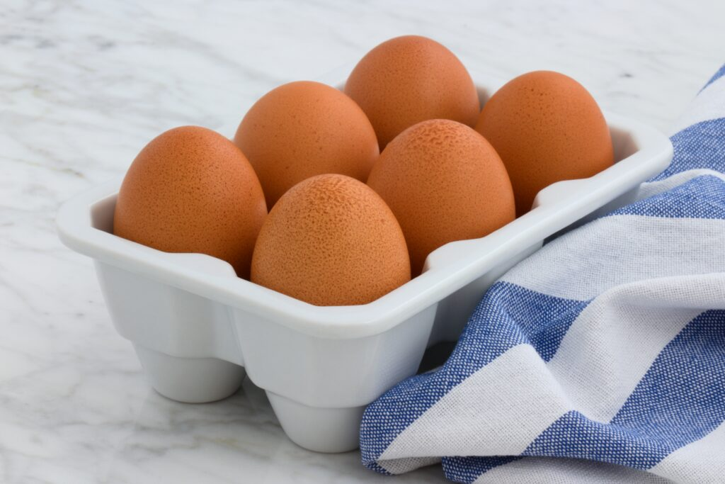 New Hampshire chickens lays light to brown eggs.